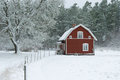 Winter in the swedish coutryside typical red farm home a snowstorm Stock Photography