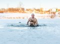 Winter swimming. Man in ice-hole Royalty Free Stock Photo