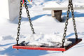 Winter swing single with snow on it Royalty Free Stock Photography
