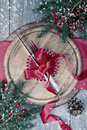Winter table setting with knife and fork tied with red ribbon Royalty Free Stock Photos