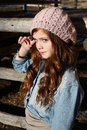 Winter teen girl leaning against a wooden fence Stock Photos