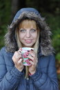 Winter time beautiful young woman cup tea coffee Royalty Free Stock Photo