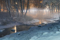 Winter-time fog over brook by night Royalty Free Stock Photo