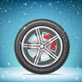 Winter tire on snowy background Royalty Free Stock Photo