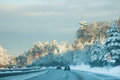 Winter traffic roadway in at sunrise with changing light Royalty Free Stock Image