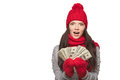 Winter us dollar woman excited surprised showing fan of money in hand over white background with copy space Royalty Free Stock Photo