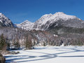 Winter view of frozen surface of strbske pleso tarn and massive peaks high tatra mountain range in background strbske pleso is Stock Photography