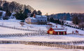 Winter view of a house and barn on farm in rural Carroll County, Royalty Free Stock Photo