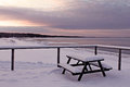 Winter view to the beach with a bench full of snow estonia Stock Photography