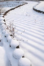 Winter walkway the snow covered in wooden footpath Royalty Free Stock Photos