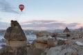 Winter warm dawn with red balloon on hotfire balloons festival, cappadocia, turkey, kappadokya Royalty Free Stock Photo