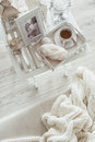 Winter weekend still life details cup of tea and knitting on retro vintage wooden tray on a coffee table in living room top view Royalty Free Stock Photo