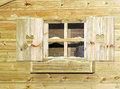 Winter window small with blinds at cabin Royalty Free Stock Photos