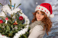 Winter woman with christmas tree portrait of in snow and hat santa claus and Royalty Free Stock Photography