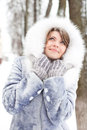 Winter woman dreaming in white furs looking up Royalty Free Stock Photo