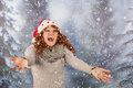 Winter woman with hat of christmas santa in snow portrait and claus Royalty Free Stock Photo