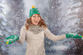 Winter woman with hat of christmas tree in snowstorm portrait snow and and gloves and lots fun Royalty Free Stock Photo