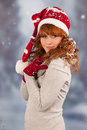 Winter woman with hat of santa claus in snow portrait and christmas Royalty Free Stock Photos