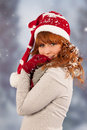 Winter woman with hat of santa claus in snow portrait and christmas Stock Photos