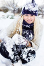 Winter woman playing with snow beautiful Royalty Free Stock Image