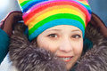 Winter woman in rainbow hat Stock Photo