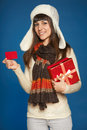 Winter woman with red gift box and credit card christmas x mas celebration smiling in warm hat scard holding showing blank Royalty Free Stock Images