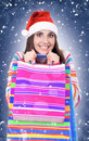 Winter woman with santa hat holding shopping bags Stock Image