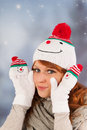Winter woman with snowman hat portrait of in snow and Stock Image