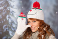Winter woman with snowman hat portrait of in snow and Stock Photography
