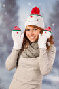 Winter woman with snowman hat portrait of in snow and Stock Images