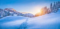 Winter wonderland in the Alps with mountain chalet at sunset Royalty Free Stock Photo