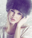Wintertime beautiful woman with hat in winter with snow Royalty Free Stock Photography