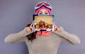 Wintertime female holding christmas tablet for winter Stock Photo