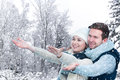 Wintertime happy young couple enjoying Stock Photography