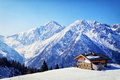 Wintertime old house at the european alps in winter Royalty Free Stock Photos