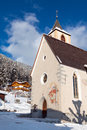 Wintertime view small church tall steeple vila di sopra sud tyrol Stock Photos