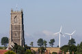 WINTERTON-ON-SEA, NORFOLK/UK - AUGUST 4 : New windmills and old Royalty Free Stock Photo