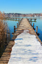 Wintry boardwalk at starnberg lake germany with snow Royalty Free Stock Photos