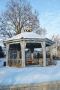 Wintry gazebo snow covered in a garden Stock Image