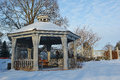 Wintry gazebo winter garden and setting Stock Image