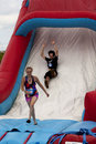 Wipeout k run obstacles course the drop woman and man at slide obstacle at in wilmington delawarennthe is themed Royalty Free Stock Photos