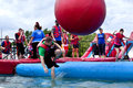 Wipeout k run obstacles course wrecking balls man falling at the water obstacle at the in wilmington delaware the is Stock Photos