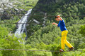 Wire bridge in glen nevis a young man crosses the gelen scotland with the falls of steall the background Royalty Free Stock Images