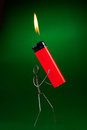 Wire character with red lighter Royalty Free Stock Photo