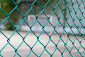Wire fence with futsal field on background Stock Photo