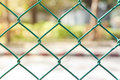 Wire fence with futsal field on background Royalty Free Stock Image