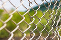 Wire fence with futsal field on background Royalty Free Stock Images