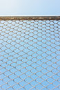 Wire fence with futsal field on background Royalty Free Stock Photo