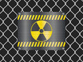 Wire fence and radiation sign Royalty Free Stock Photos