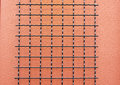 Wire grid stucco wall Stock Photography